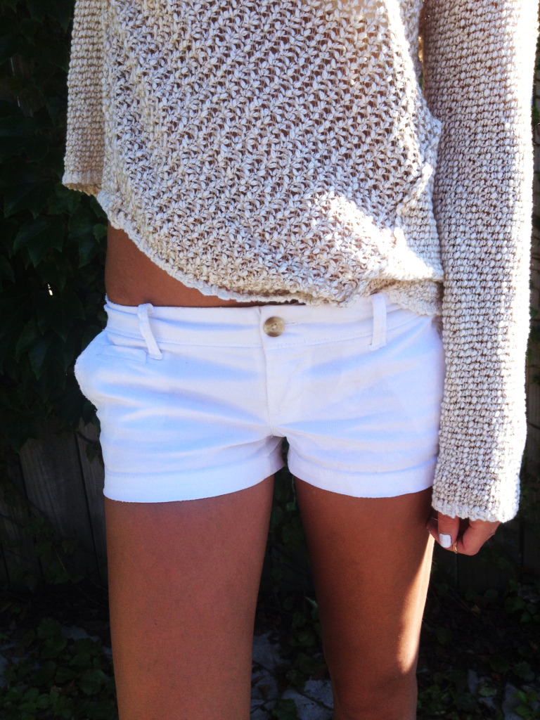 Loose knit sweaters are a late summer must.