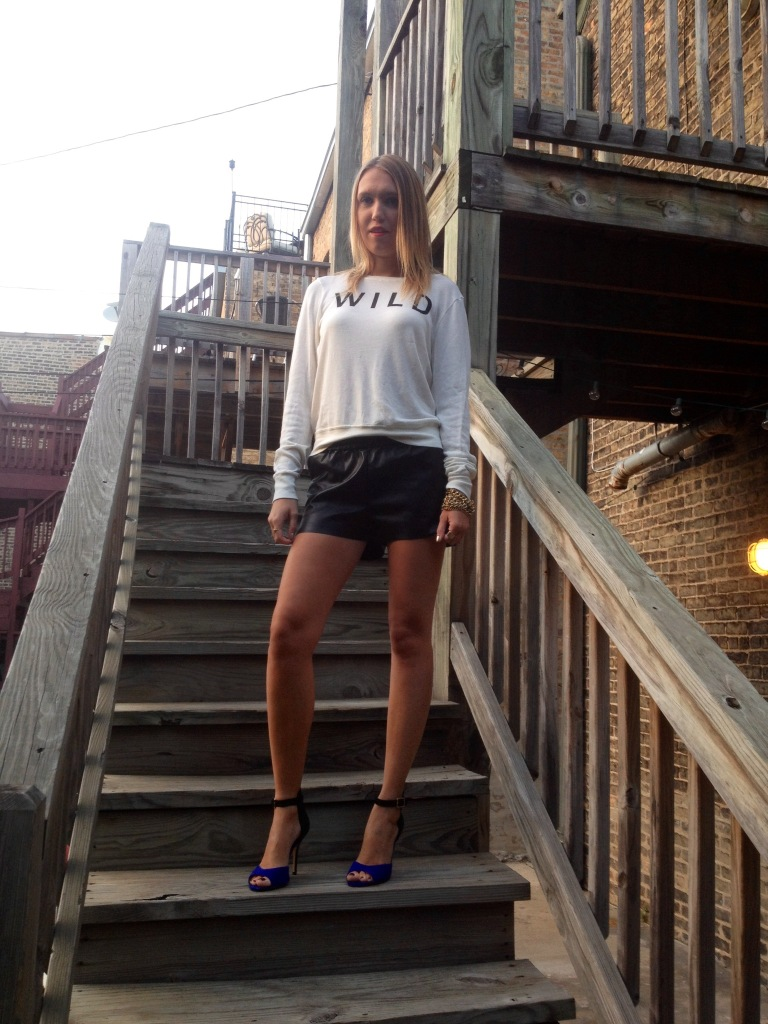 Sweatshirt: Wildfox; Shorts: H&M; Shoes: Steve Madden.